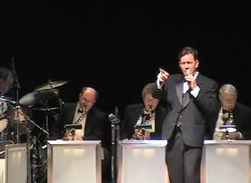 Vocalist Frank Lamphere sings with a big band